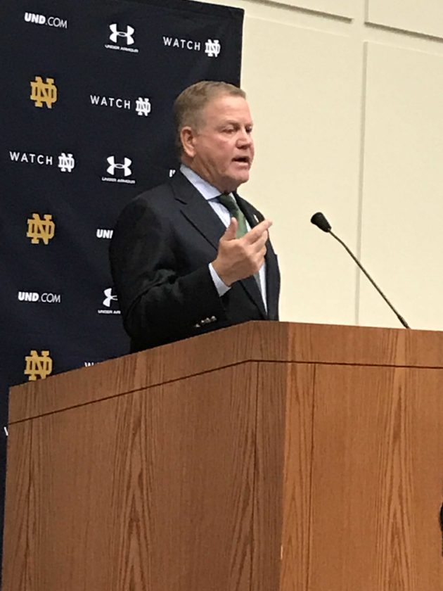 Notre Dame football coach Brian Kelly speaks to the media at the Guglielmino Athletics Complex Wednesday in South Bend. The Fighting Irish coaches were taking part in festivities for National Signing Day. (By Tom Davis of News-Sentinel.com)
