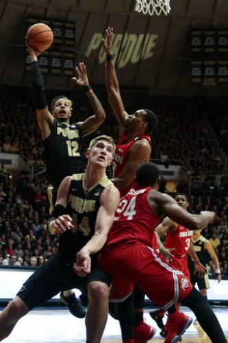 Purdue forward Vincent Edwards, left, shoots around Ohio State forward Keita Bates-Diop, right, during the second half of an NCAA college basketball game in West Lafayette, Ind., Wednesday, Feb. 7, 2018. Ohio State won 64-63. (AP Photo/AJ Mast)