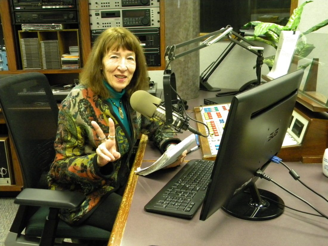 "Julia Meek flashes her trademark peace sign in the studio where she records her ""Folktales"" program at local public radio station WBOI, 89.1-FM. Meek has been hosting the weekly world tour of folk music for 35 years. (By Kevin Kilbane of News-Sentinel.com)"