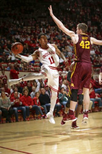 Indiana guard Devonte Green (11) passes around Minnesota forward Michael Hurt (42) during the second half of a game in Bloomington Friday. Indiana won 80-56. (By The Associated Press)