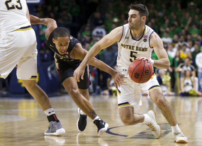 Notre Dame's Matt Farrell (5) moves by Florida State's CJ Walker (2) during the second half of a game Saturday in South Bend. (By The Associated Press)