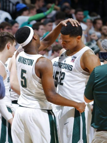 Michigan State's Cassius Winston, left, and Miles Bridges celebrate following a 68-65 win over Purdue in a game Saturday in East Lansing, Mich. Michigan State won 68-65. (By The Associated Press)