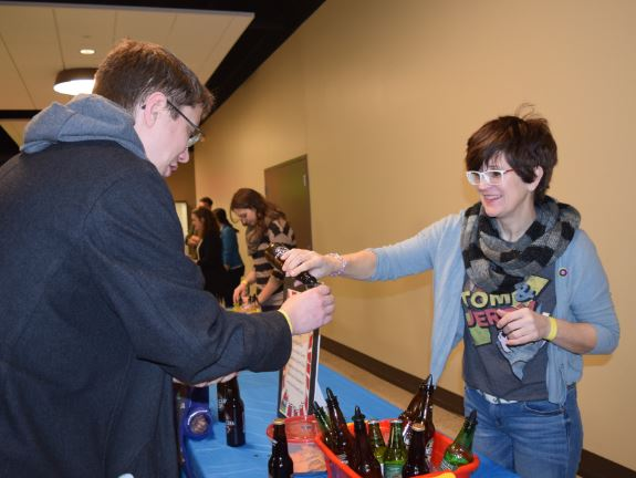 An attendee of the inaugural Fizz Fest 2018 - Summit City Craft Soda Festival & Winter Carnival on Saturday at USF Performing Arts Center gets a sample of one of the many craft sodas available. (Photo by Lisa M. Esquivel Long of News-Sentinel.com)
