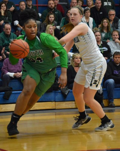 South Side senior Taniece Chapman drives baseline past Kaylee Riggins of Zionsville during Saturday's Kokomo Regional championship. (By Justin Kenny of news-sentinel.com)
