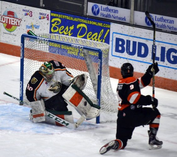 Quad City goaltender C.J. Motte throws a pad out to stop a first period shot from Fort Wayne's Mason Baptista. (By Blake Sebring of News-Sentinel.com)