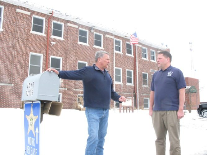 Sheriff Dave Gladieux, left, and program Director Michael Biltz stand outside the county's work-release center at 12103 Lima Road. County Council this week is expected to OK $5 million for a move into a former state juvenile jail on Venture Lane. (Photo by Kevin Leininger of The News-Sentinel.com)