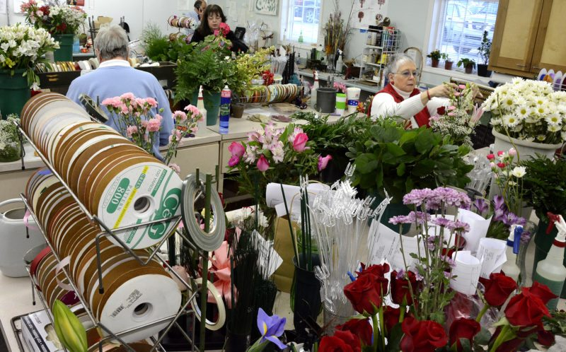 2015 - All hands were on deck Thursday as floral designners worked on getting the orders out for Valentines Day at Cottage Flowers.