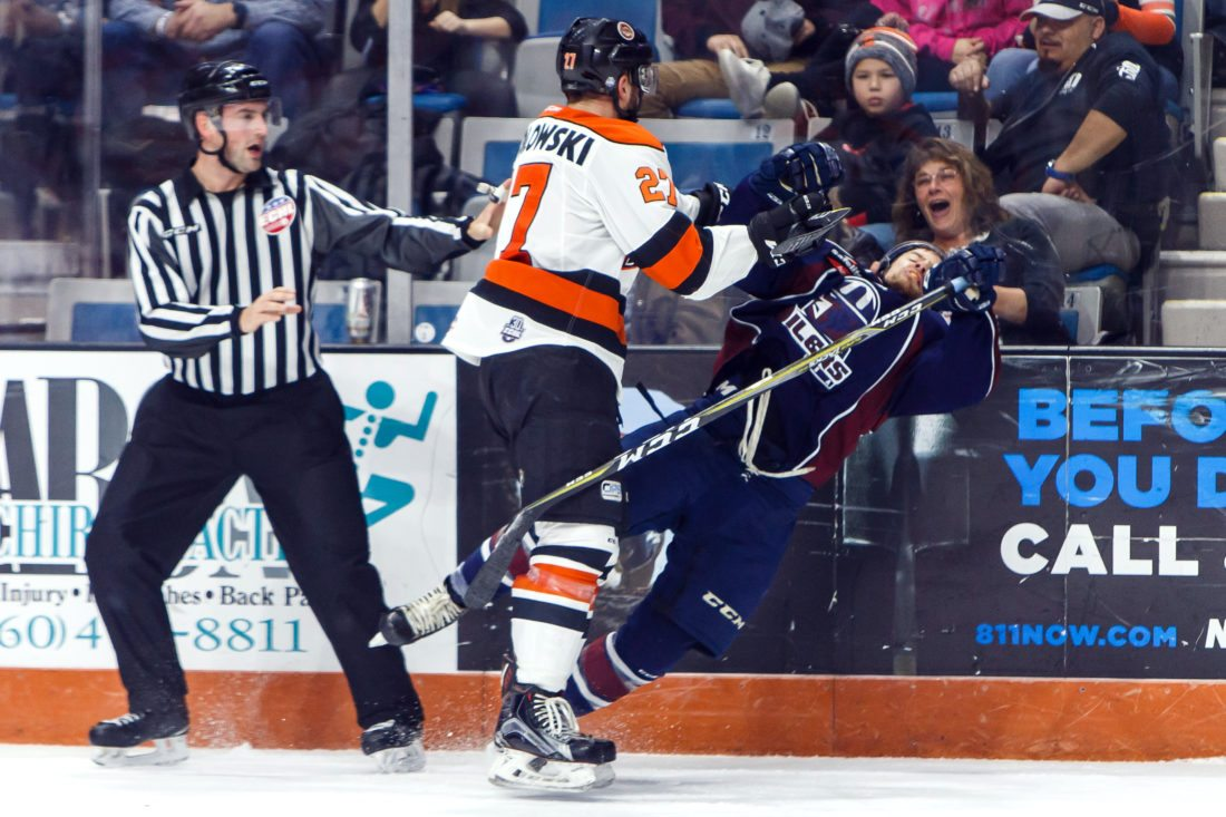 Komets forward Shawn Szydlowski hits Tulsa's Dylan Hubbs during a Nov. 19 game at Memorial Coliseum. Szydlowski received cross checking and roughing penalties on the play. (By Josh Gales for The News-Sentinel)