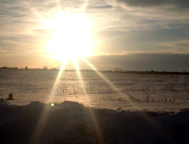 2014 - The sun sets over the wintery landscape of a corn field off West Hamilton Road.
