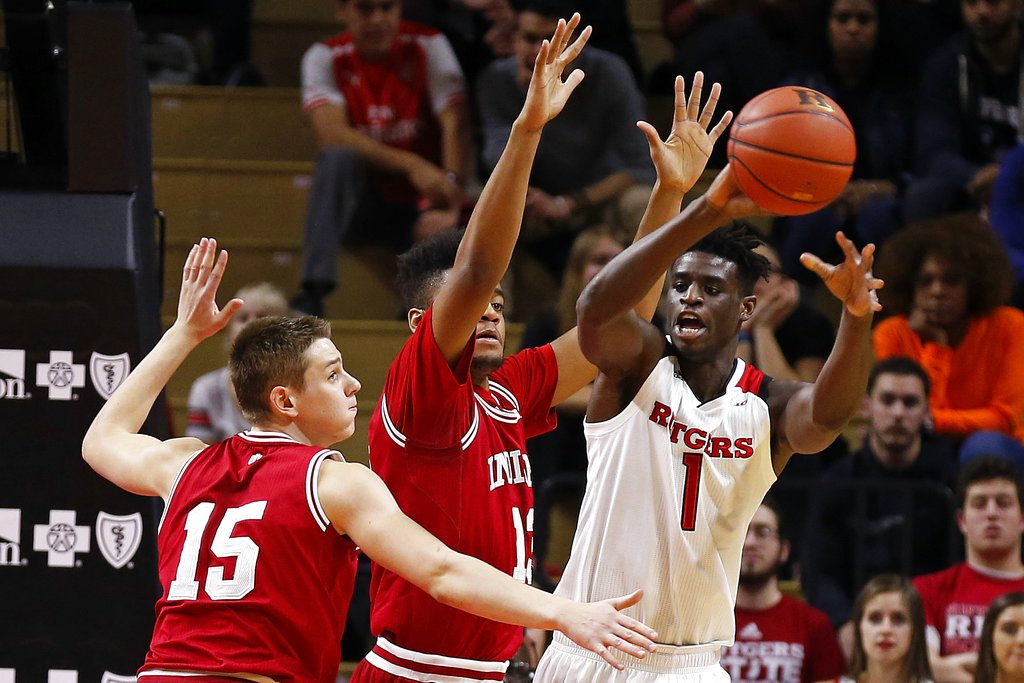 Rutgers forward Candido Sa (1) passes while being defended by Indiana forward Juwan Morgan and guard Zach McRoberts (15) during the first half of a recent game in Piscataway, N.J. (By The Associated Press)
