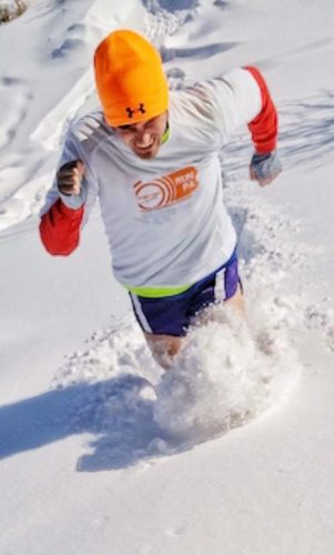 A runner plows through a snow drift during the 2000 running of the HUFF 50K Trail Race. The annual December event at Chain O'Lakes State Park near Albion is known for its challenging conditions, which in 2016 included snow and freezing rain and in 2017 took place during a below-zero windchill.  (courtesy image)