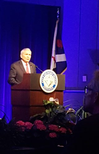 Mayor Tom Henry stands in front of the crowd at the Grand Wayne Center on Wednesday to deliver his 11th State of the City Address. (By Brad Saleik of news-sentinel.com)