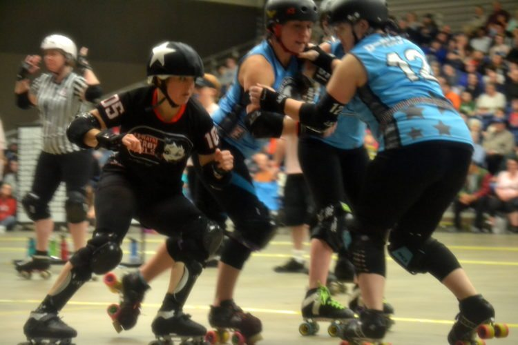 Veteran Fort Wayne Derby Girls skater Traci McBride looks for an opening during a match last year at Memorial Coliseum. (By Blake Sebring of News-Sentinel.com)