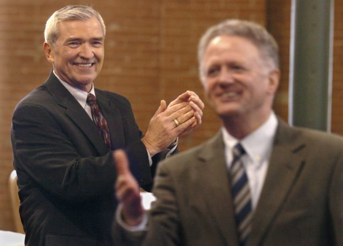 2007 - Former Fort Wayne city councilman Tom Henry, left, applauds as Mayor Grahm Richard is introduced, prior to Henry's announing his candidacy for Mayor, Wednesday morning at Bergstaff Place, 2020 E. Washington Boulevard.