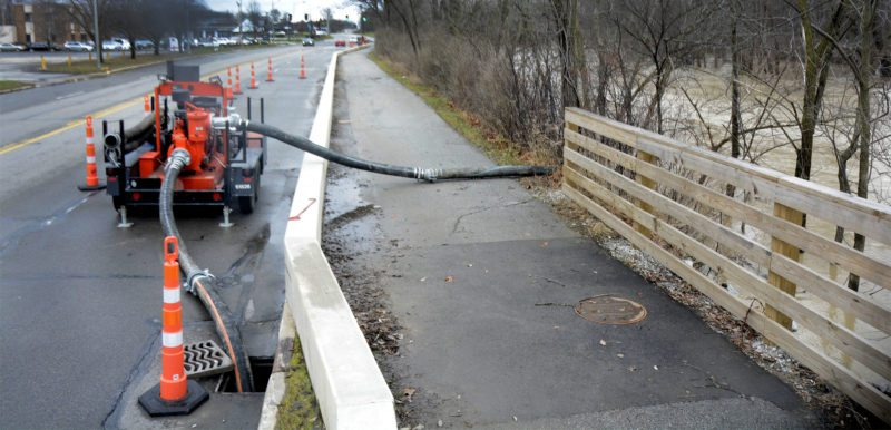 A 6-inch pump was put out by the city of Fort Wayne in December 2015 on Tillman Road  to keep high water from the St. Marys River in check. The city has some pumps out to prevent street and neighborhood flooding  with the ongoing rain Monday and more rain expected over the next few days. (News-Sentinel.com file photo)