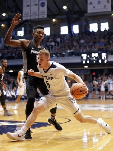 Butler guard Paul Jorgensen (5) drives on Providence forward Rodney Bullock (5) in the first half of a recent game in Indianapolis. (By The Associated Press)
