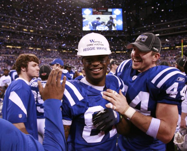Indianapolis Colts wide receiver Reggie Wayne, center, broke out the hard hat he wore on the first day of training camp as he and tight end Dallas Clark celebrate after the Colts' beat the New York Jets 30-17 in the 2009 AFC Championship game at Lucas Oil Stadium. (File photo by news-sentinel.com)