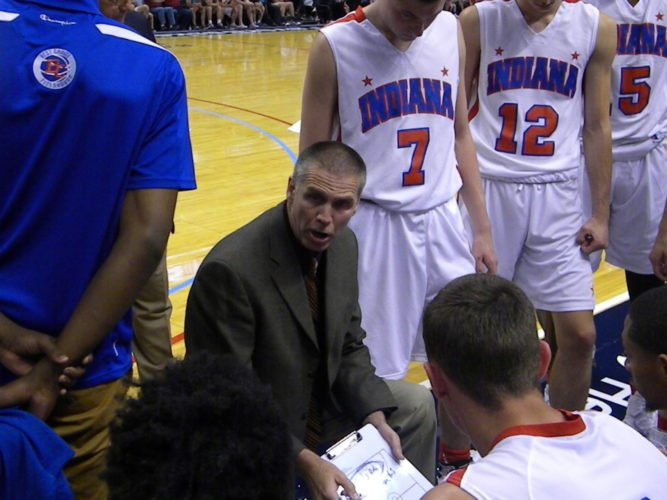 Longtime Carroll High School boy's basketball coach Marty Beasley speaks to the Indiana All-Star squad during a timeout that he coached last June against Kentucky in the annual series. (By Tom Davis of News-Sentinel.com)