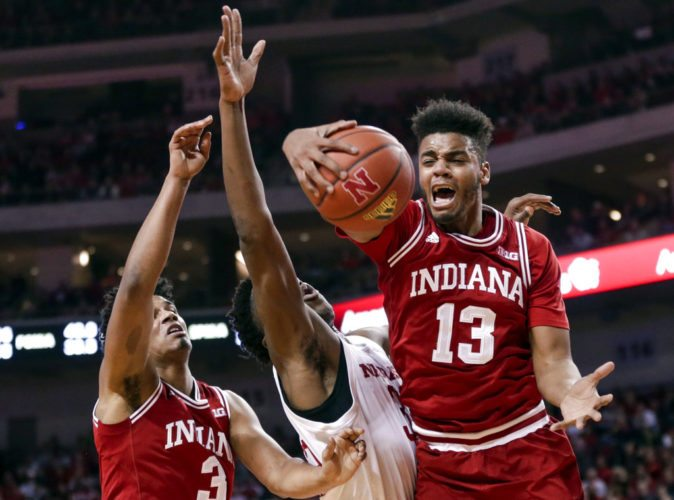 Indiana's Juwan Morgan (13) and Justin Smith (3) and Nebraska's Jordy Tshimanga, center, vie for a rebound, won by Morgan, during the first half of a game in Lincoln, Neb. Tuesday. (By The Associated Press)
