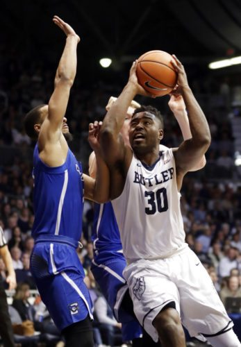 Butler forward Kelan Martin (30) shoots over Creighton guard Davion Mintz (1) during the first half of a game in Indianapolis Tuesday. (By The Associated Press)