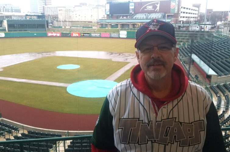 Lenny Baughman of Auburn stands at his club seats view after being first in line for Fort Wayne TinCaps single-game ticket sales Wednesday at Parkview Field. (Photo by Reggie Hayes of news-sentinel.com)