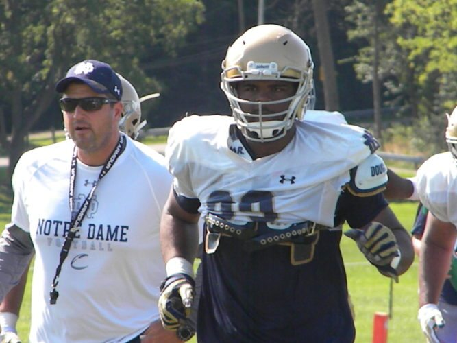 Notre dame associate head coach Mike Elston and Irish defensive lineman Jerry Tillery run to the next station during a training camp practice last August at Culver Academy. (By Tom Davis of News-Sentinel.com)