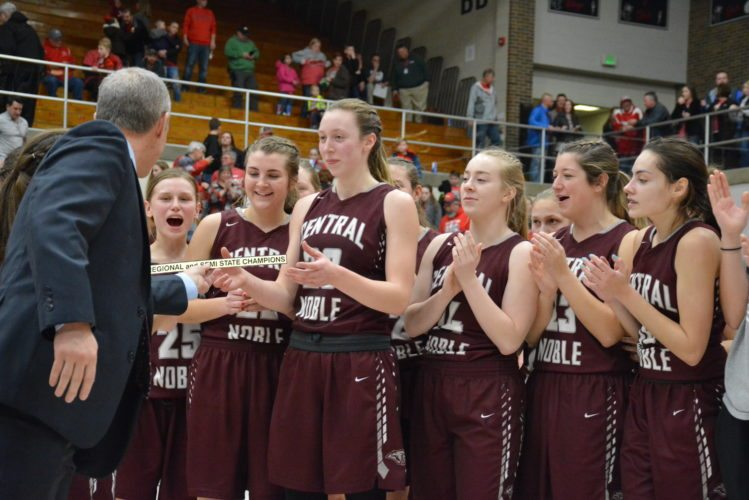 The Central Noble girls basketball team accepts their regional and semistate champion placard last weekend. (Photo by Dan Vance of news-sentinel.com)