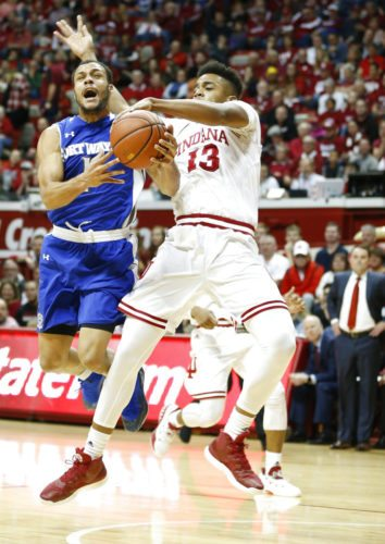 Indiana's Juwan Morgan, right, goes for the ball against Fort Wayne's Bryson Scott (1) during a game earlier this season in Bloomington. (By The Associated Press)