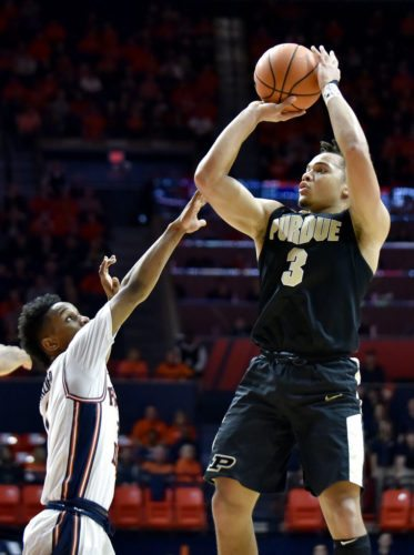 Purdue guard Carsen Edwards (3) shoots over the reach of Illinois guard Trent Frazier during the second half of a game in Champaign, Ill. Thursday. Purdue won 93-86. (By The Associated Press)