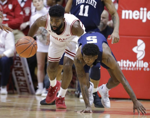 Indiana's Robert Johnson, left, and Penn State's Jamari Wheeler eye a loose ball during the first half of a game earlier this season in Bloomington. (By The Associated Press)