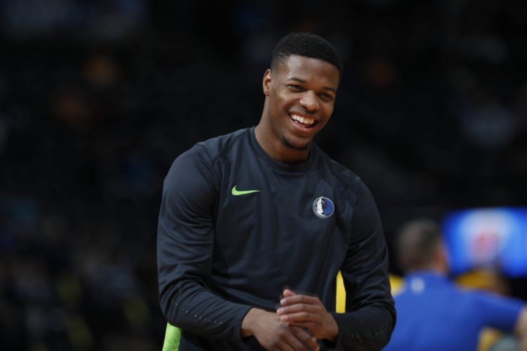 Dallas Mavericks guard Dennis Smith Jr. is one of dozens of current and former college basketball players named in federal documents detail potential NCAA violations. (Associated Press photo)