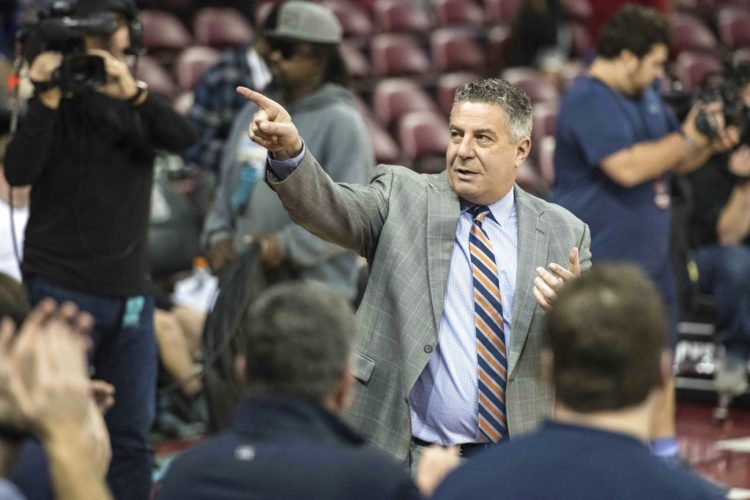 Auburn University men's basketball coach Bruce Pearl points at Auburn fans before a game earlier this season in Columbia, S.C. The Tiger program is immersed in scandal, as it relates to an on-going FBI investigation into corruption in college athletics. (By The Associated Press)