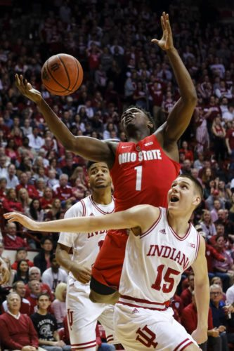 Ohio State forward Jae'Sean Tate (1) goes for a rebound behind Indiana guard Zach McRoberts (15) during the first half of a game in Bloomington Friday. (By The Associated Press)