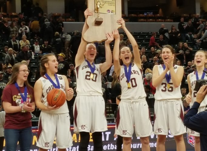Members of the Central Noble girls basketball team hold aloft the Class 2A state championship trophy following Saturday's win over Winchester at Bankers Life Fieldhouse in Indianapolis. (By Justin Kenny of news-sentinel.com)