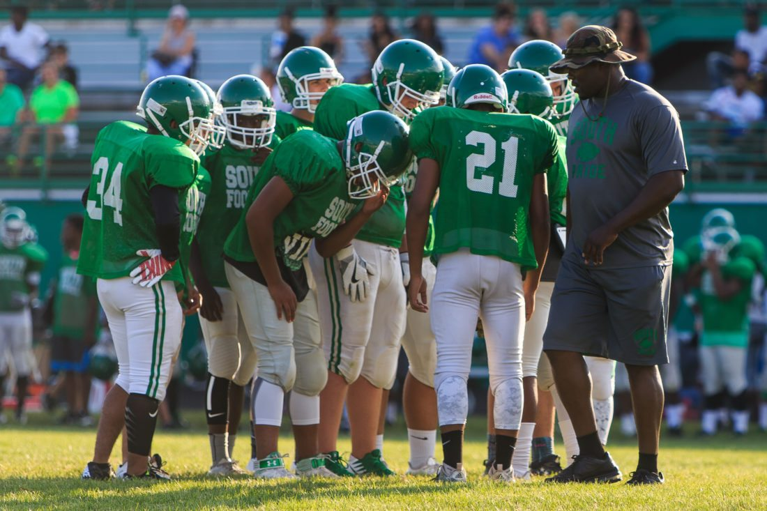 South Side coach Roosevelt Norfleet oversees as his team huddles during a 2017 scrimmage with Wayne. (File photo by news-sentinel.com)