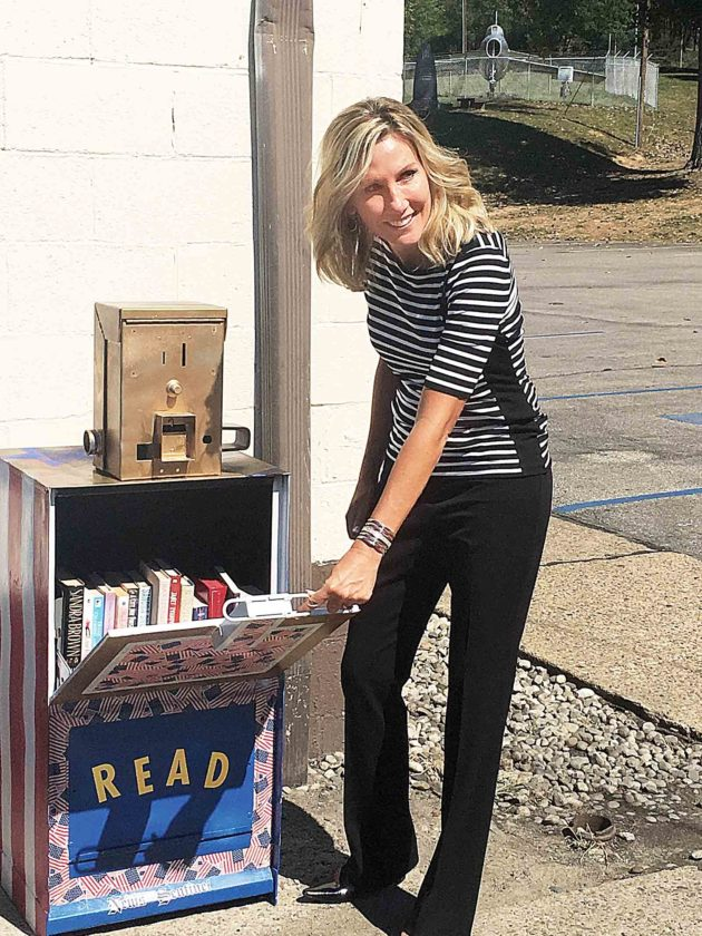 Jan Dils shows the new Little Free Library is already full of books at Jackson Park in Vienna. (Photo Provided)