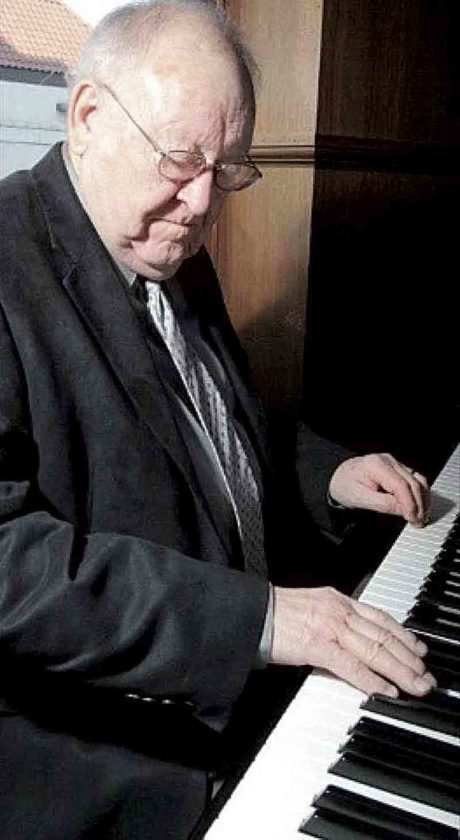 Photo Provided Bruce DeMoll at the piano during a performance of the Smoot House Band. DeMoll died on Wednesday at his residence in Vienna.