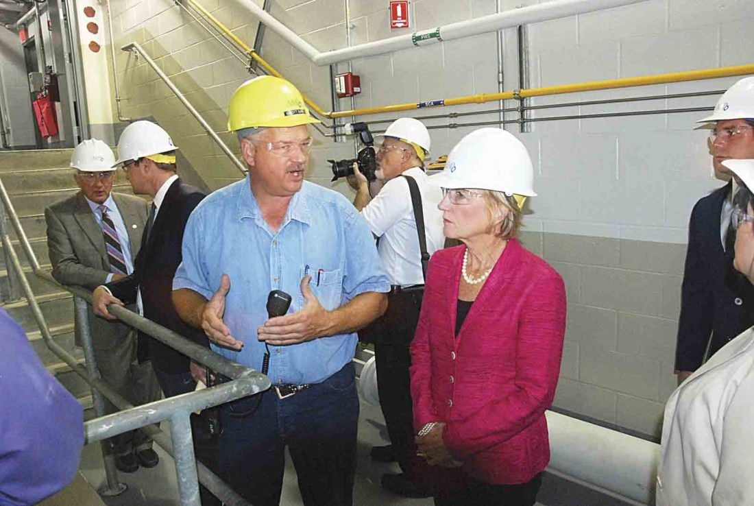 Scott Barta, left, director of hydroelectric power for American Municipal Power, talks with U.S. Sen. Shelley Moore Capito, R-W.Va., right, about the Willow Island Hydroelectric Facility during a tour following the ribbon-cutting at the Ohio River site Tuesday. (Photo by Evan Bevins)