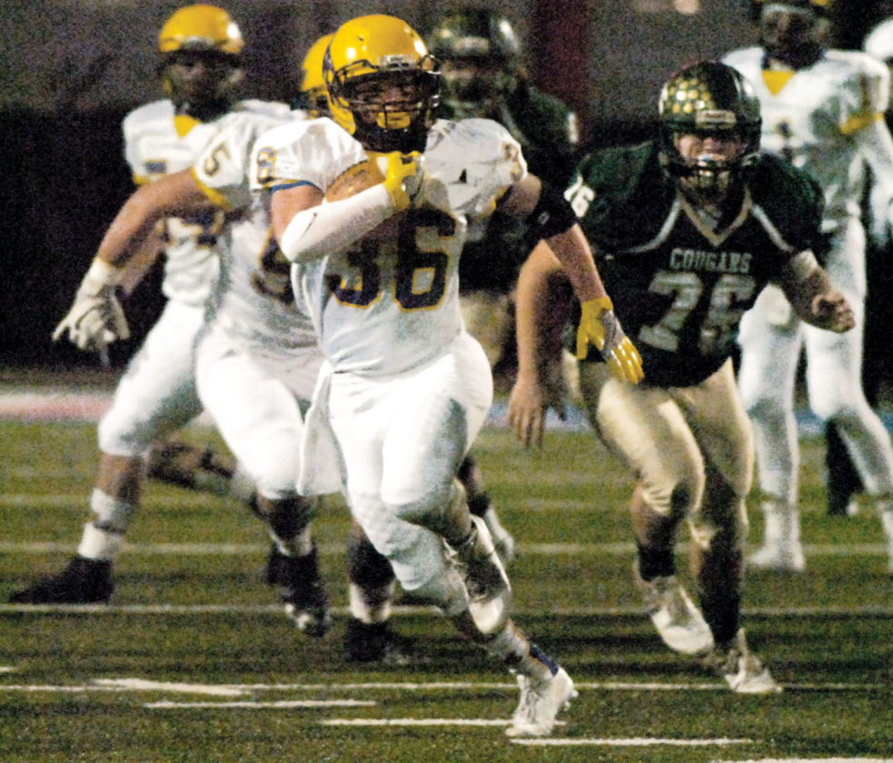 St. Marys' running back Braden Barnhart finds running room for a big gain on a drive early in the first quarter.