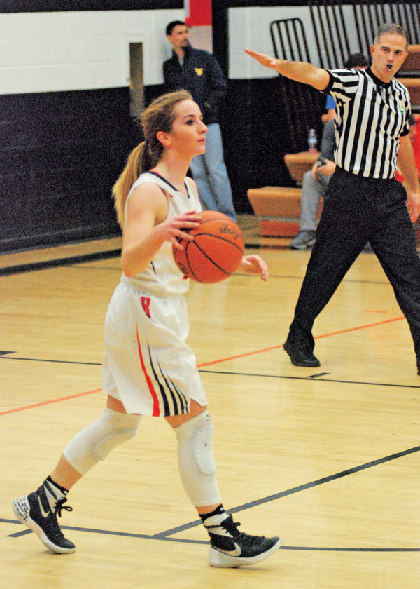 Belpre senior guard Cheyenne Barker dribbles the basketball upcourt Thursday night versus visiting Eastern. Barker scored her 1,000th career point in the game and finished with 15 points, but Belpre lost to Eastern, 61-41. Photo by Steve Hemmelgarn.