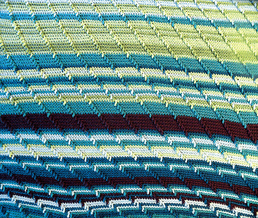 "Photo by Jeff Baughan The pattern of  the temperature blanket is called ""Apache Tears"" on Pinterest.  The blanket measures 60 inches wide by 100 inches long."