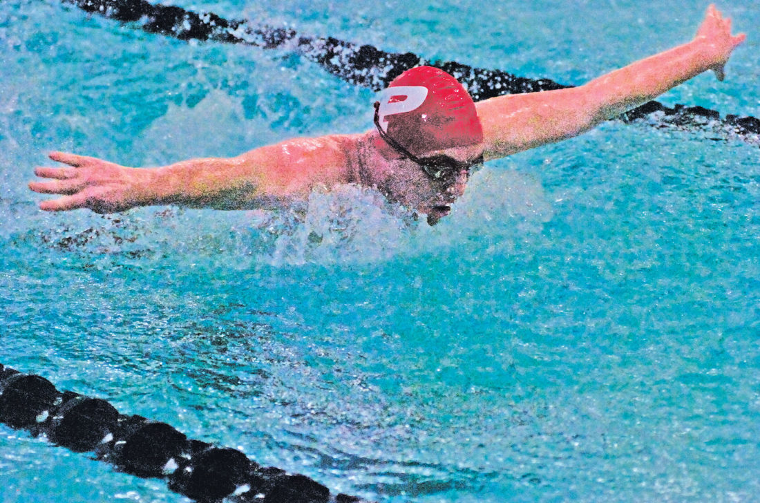Parkersburg's Quentin Oliphant swims the butterfly leg of the 200 medley relay during the Patriot Invitational Saturday at the Parkersburg Boys and Girls Club. The Big Reds finished second in the event and the boys team won the meet. Photo by Joe Albright.