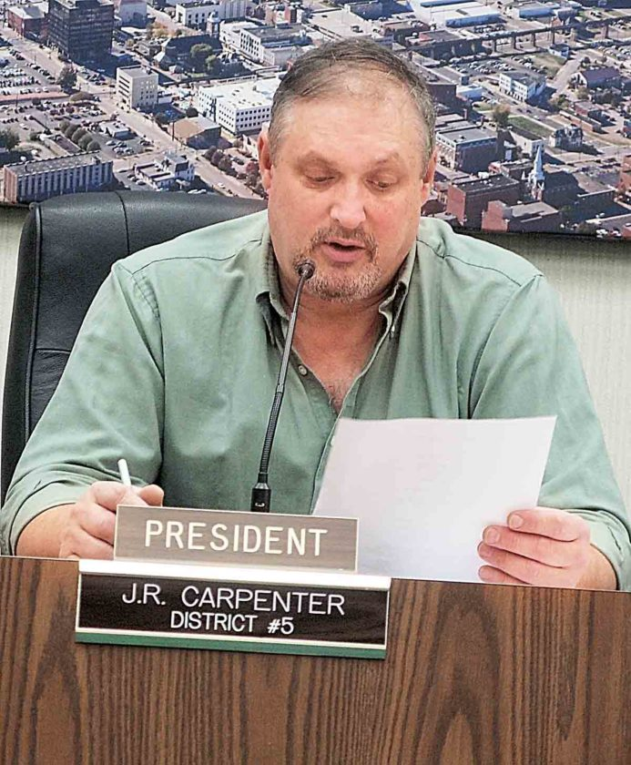 Parkersburg City Council President J.R. Carpenter reads the list of committee appointments during Tuesday's council meeting at the Municipal Building. (Photo by Evan Bevins)