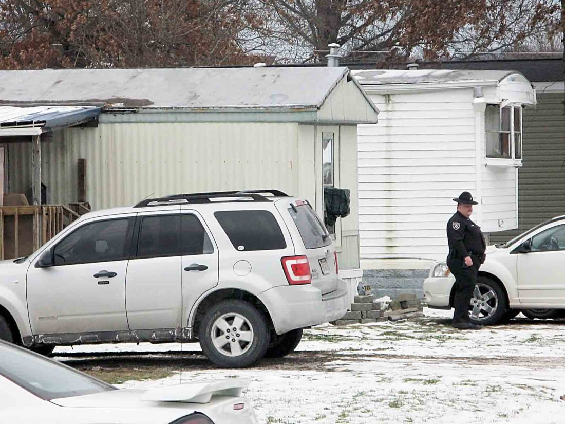 A deputy with the Wood County Sheriff's Department Tuesday morning stands outside the mobile home on Nova Road in Mineral Wells where two people were fatally shot. Suspect Jeff Sampson, 46, was arrested around 12:30 p.m. after a pursuit on Interstate 79 in Braxton County by West Virginia State Police. (Photo by Michael Erb0)