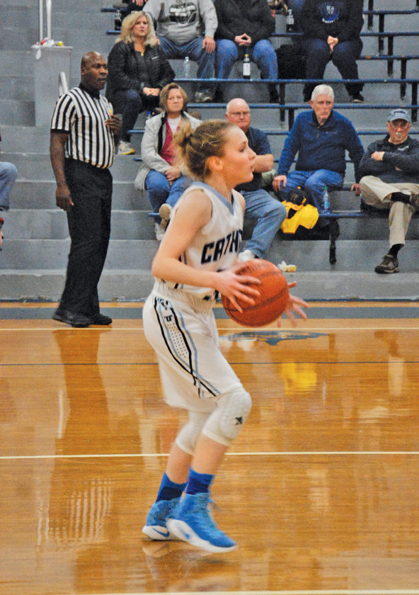 Parkersburg Catholic's Madeline Huffman looks to pass during a high school basketball game Tuesday against Tyler Consolidated. Photo by Steve Hemmelgarn.