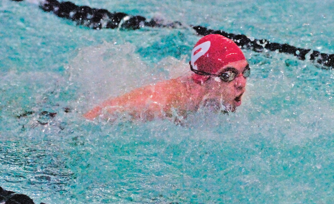 Parkersburg's Quentin Oliphant swims the butterfly leg of the 200 medley relay during the Patriot Invitational earlier this season at the Parkersburg Boys and Girls Club. The Big Reds finished second in the event. Photo by Joe Albright.