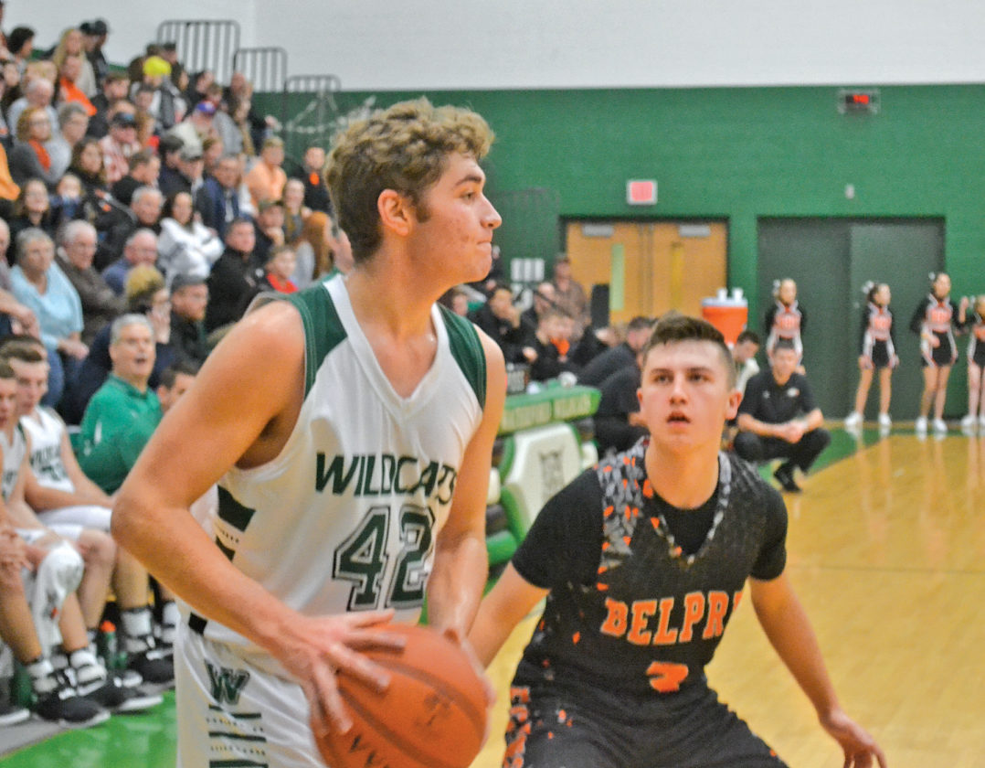 Waterford's Tanner Pottmeyer, left, looks to pass as Belpre's Cole Knotts defends during a high school boys basketball game Friday night at the Harry Cooper Annex inside Waterford Elementary. Both players led their respective teams in scoring. Photo by Ron Johnston.