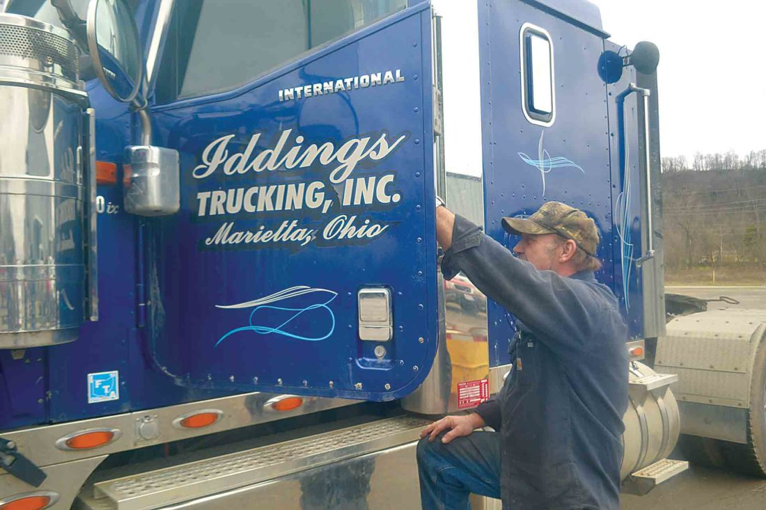 Photo by Peyton Neely Danny Price, mechanic and truck driver for Iddings Trucking Inc., gets into one of the company trucks.