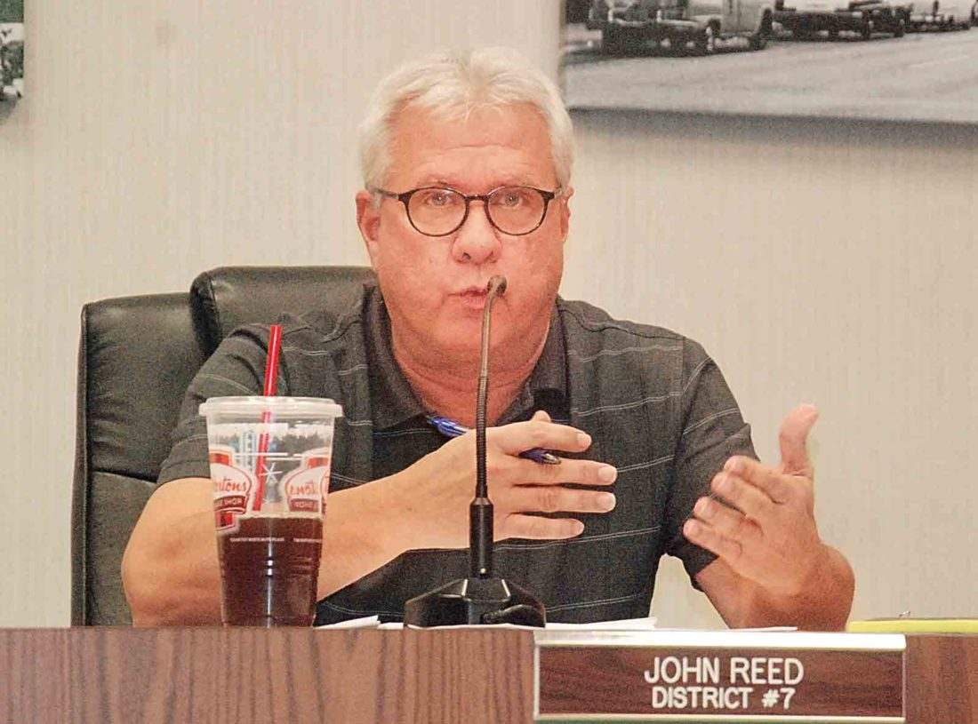 Parkersburg City Councilman John Reed explains the reasoning behind the council's new motto during Tuesday's council meeting. The motto was unanimously approved. (Photo by Evan Bevins)