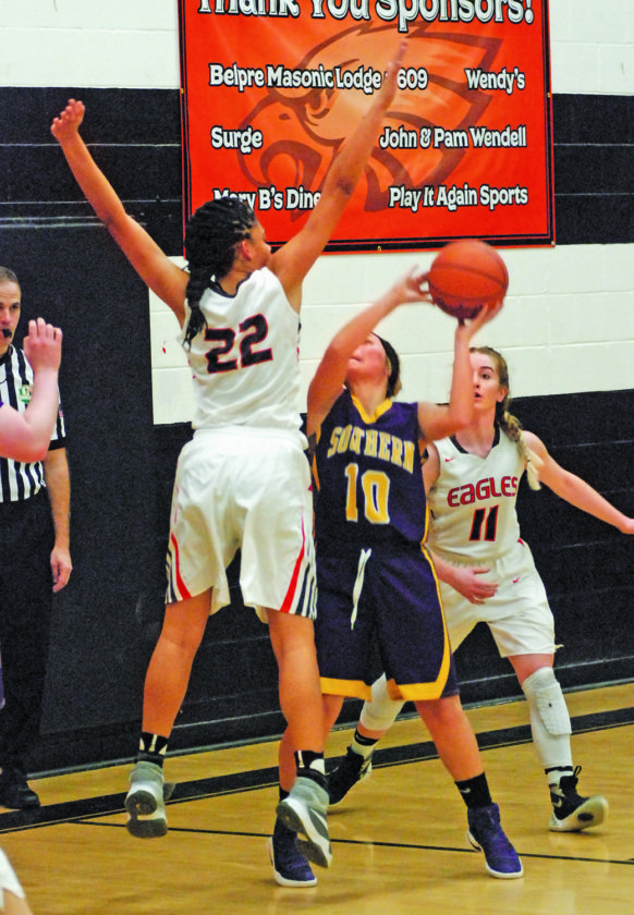 Belpre's Kyna Waderker (22) prepares to block a shot by Southern's Jaiden Roberts (10) Thursday night as Golden Eagle player Cheyenne Barker (11) watches. Belpre won 54-43 over the visiting Tornadoes. Photo by Steve Hemmelgarn.